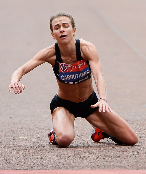 Hayley Carruthers collapses at the finish of the Virgin Money London Marathon