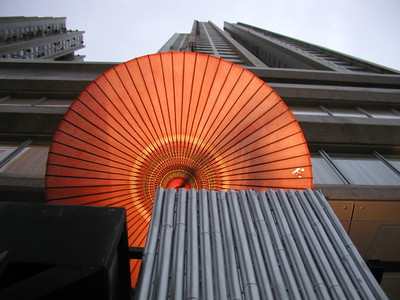 Chinese Oil paper Umbrella contrasting with high rise in Hong Kong