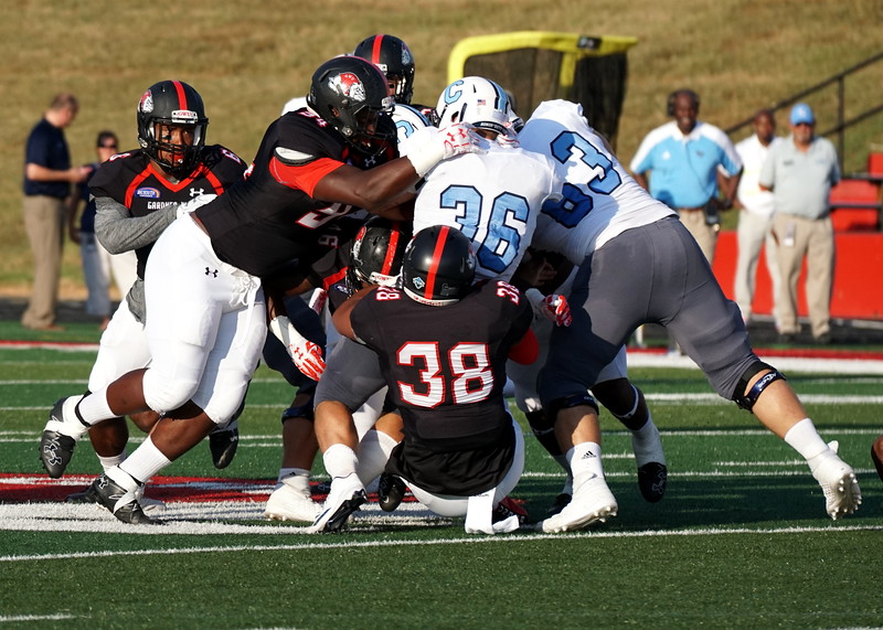 The bulldogs jump on the Citadel players.