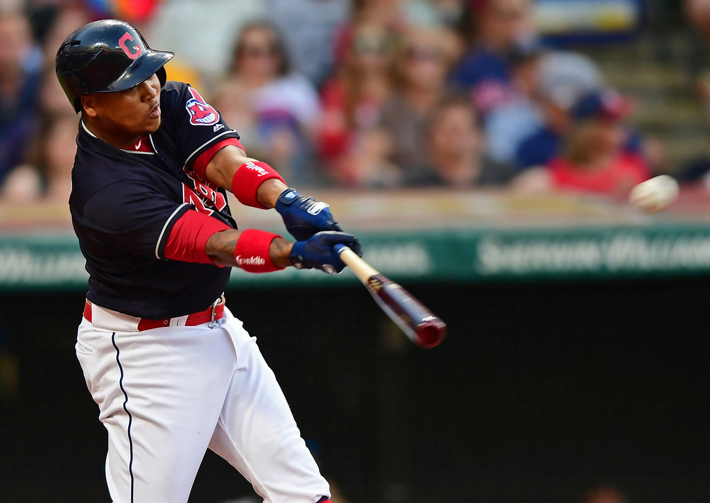 . Cleveland Indians\' Jose Ramirez hits a RBI-double in the third inning of a baseball game against the Houston Astros, Friday, May 25, 2018, in Cleveland. (AP Photo/David Dermer)