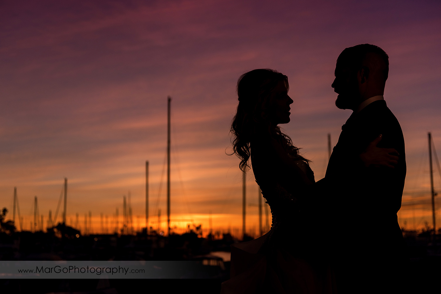 sunset silhouette of bride and groom during wedding reception at San Diego Marina Village