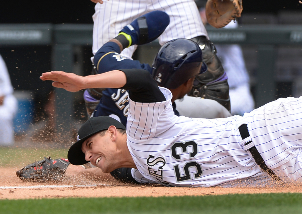 . DENVER, CO - JUNE 21: Colorado pitcher Christian Friedrich missed the tag on Milwaukee baserunner Jean Segura as he crossed the plate in the third inning. The Brewers cleared the bases on a wild pitch. The Colorado Rockies hosted the Milwaukee Brewers at Coors Field Saturday afternoon, June 21, 2014. Photo by Karl Gehring/The Denver Post