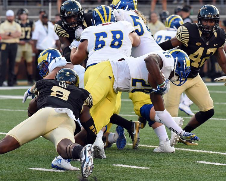 Marquel Lee tackles T Jefferson.jpg