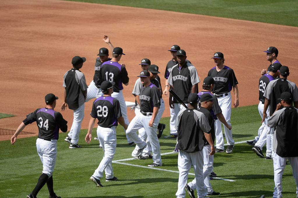 . Colorado Rockies return to the field  during an open workout session  for the fans July 18, 2013 at Coors Field. (Photo By John Leyba/The Denver Post)