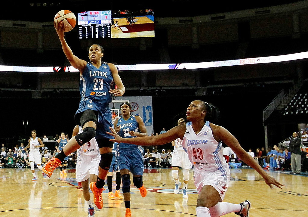 . ATLANTA, GA - OCTOBER 10:  Maya Moore #23 of the Minnesota Lynx lays in the basket against Le\'coe Willingham #43 of the Atlanta Dream during Game Three of the 2013 WNBA Finals at Philips Arena on October 10, 2013 in Atlanta, Georgia.   (Photo by Kevin C. Cox/Getty Images)