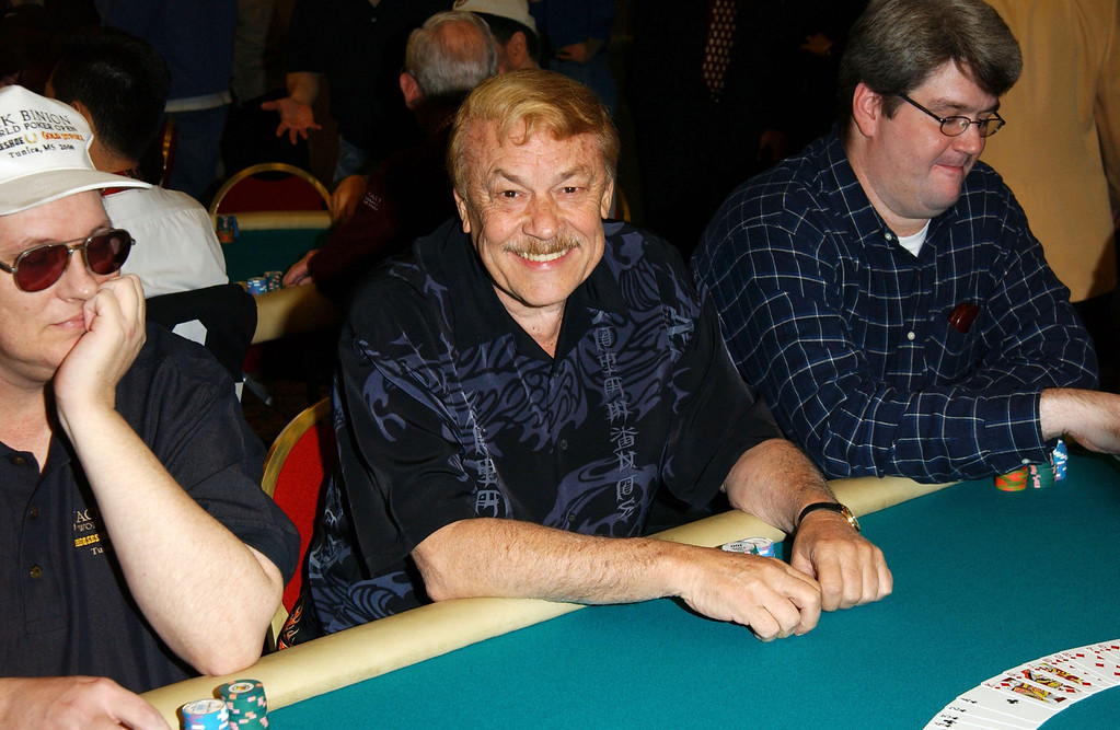 ". COMMERCE, CA - FEBRUARY 25:  Los Angeles Lakers owner Dr. Jerry Buss (C) plays poker during the ""Celebrities and Pros Match Skills As World Poker Tour Hits Los Angeles\"" at the Commerce Casino on February 25, 2003 in Commerce, California.  (Photo by Jon Kopaloff/Getty Images)"