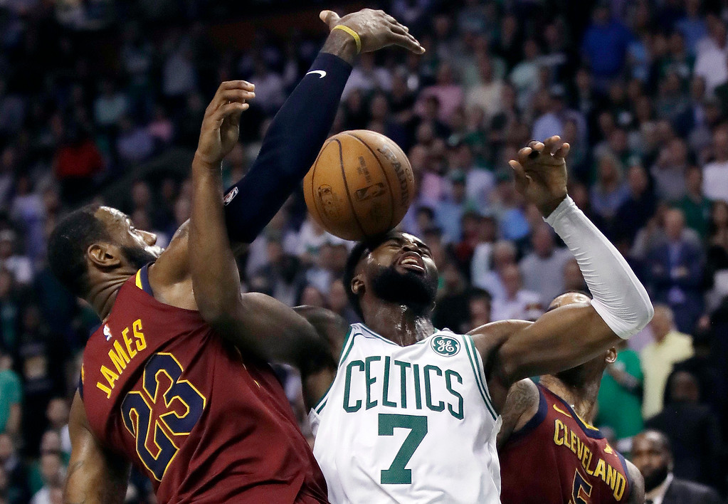 . Cleveland Cavaliers forward LeBron James, left, and Boston Celtics guard Jaylen Brown reach for a lose ball during the second half in Game 2 of the NBA basketball Eastern Conference finals Tuesday, May 15, 2018, in Boston. (AP Photo/Charles Krupa)