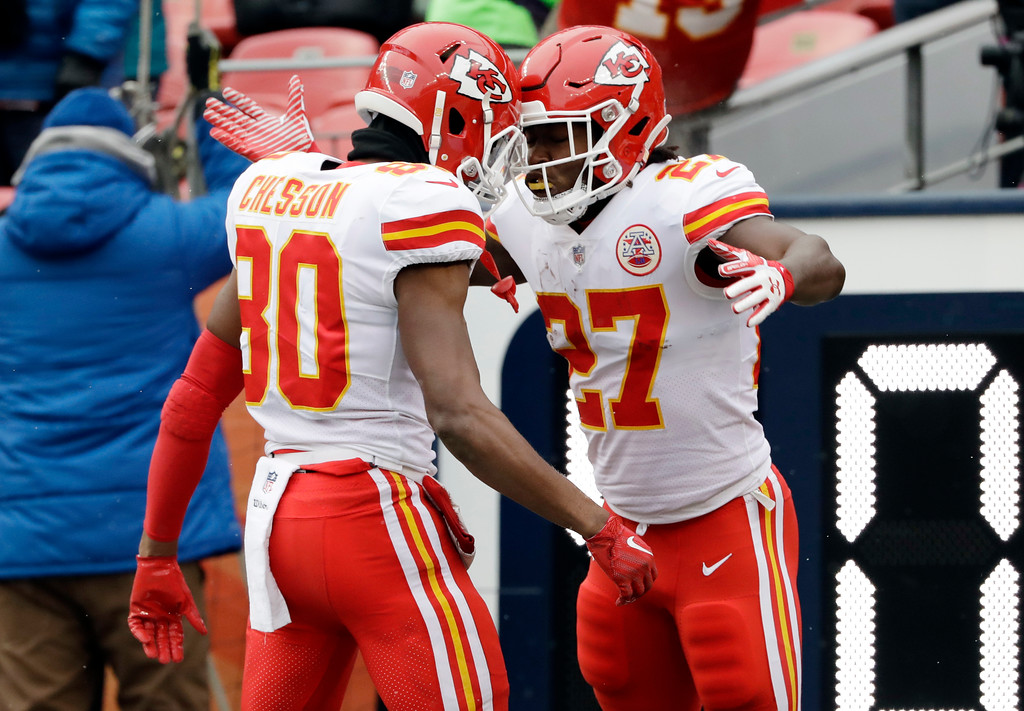 . Kansas City Chiefs running back Kareem Hunt (27) celebrates his rushing touchdown with teammate Jehu Chesson (80) during the first half of an NFL football game against the Denver Broncos, Sunday, Dec. 31, 2017, in Denver. (AP Photo/Joe Mahoney )