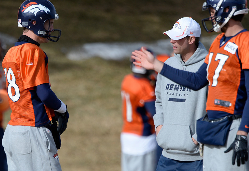 . Denver Broncos quarterback Peyton Manning (18) talks with Offensive Coordinator Adam Gase during practice January 16, 2014 at Dove Valley. The Denver Broncos are preparing for their AFC Championship game against the New England Patriots at Sports Authority Field.  (Photo by John Leyba/The Denver Post)