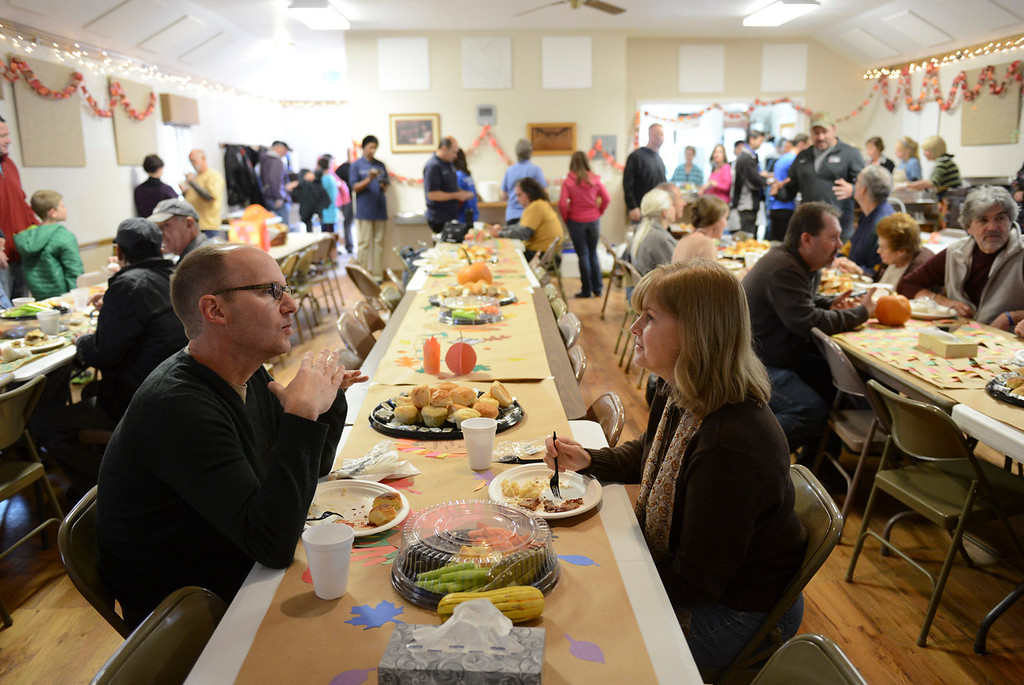 . Lyons residents Mike Porter and his wife Amy Natho finish their Thanksgiving meal Thursday Nov. 28, 2013 at Rogers Hall in Lyons. (Lewis Geyer/Times-Call)