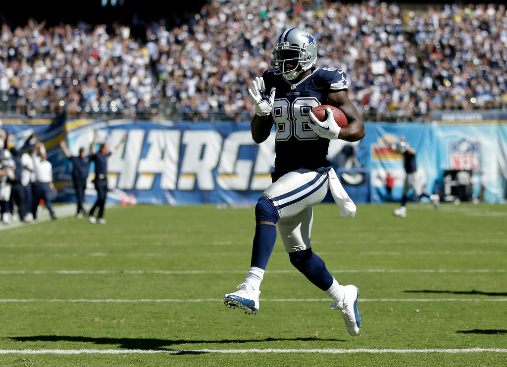 . Dallas Cowboys wide receiver Dez Bryant scores against the San Diego Chargers during the first half of an NFL football game Sunday, Sept. 29, 2013, in San Diego. (AP Photo/Gregory Bull)