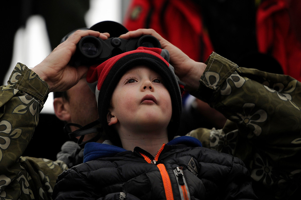 . BEAVER CREEK, CO - FEBRUARY 15: Tom Doherty watches the action through a pair of field glasses, while holding his son, Eamon, during the men\'s slalom. FIS Alpine World Ski Championships 2015 on Sunday, February 15, 2015. (Photo by AAron Ontiveroz/The Denver Post)