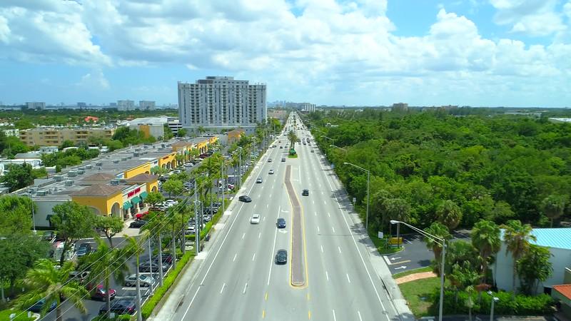 Aerial video strip mall shopping center Miami Florida