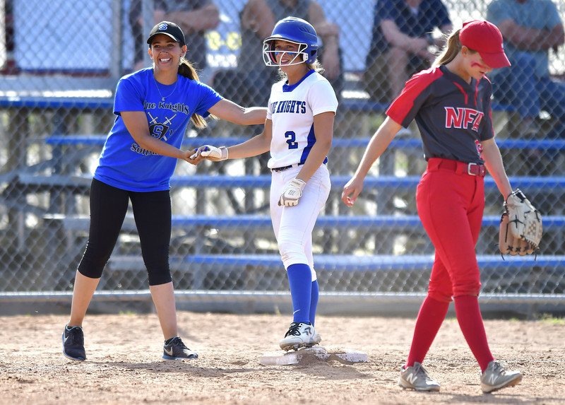 6/8/2019 Mike Orazzi | Staff Southington's Davina Hernandez   with Chrisala Marotto  (2)  and NFA's Julie Vincent 