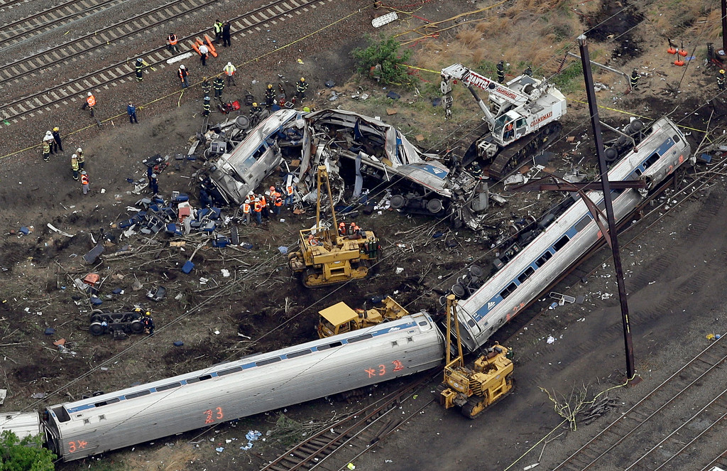 . Emergency personnel work at the scene of a deadly train derailment, Wednesday, May 13, 2015, in Philadelphia. The Amtrak train, headed to New York City, derailed and crashed in Philadelphia on Tuesday night, killing at least six people and injuring dozens of others. (AP Photo/Patrick Semansky)