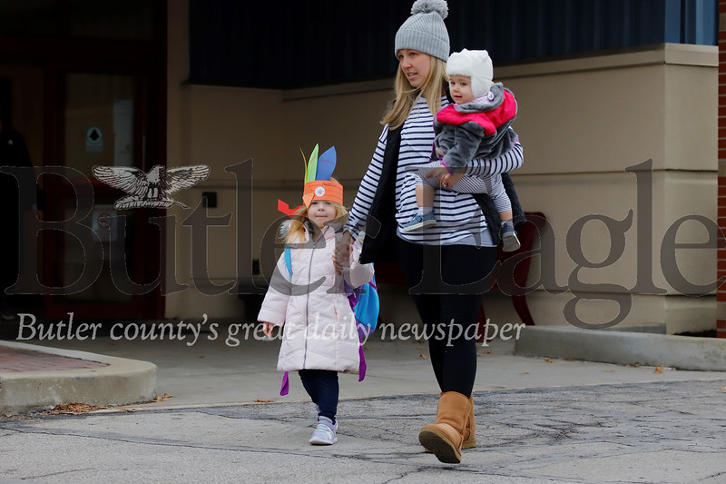 Madison Snyder, 3, leaves preschool at the Cranberry Township Municipal Building with her mom, Amanda, and sister Mila Wednesday. Seb Foltz/Butler Eagle