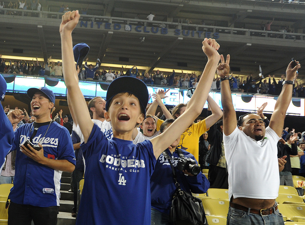 . Noah Craig,12, cheers a Dodger Home run by Andre Ethier in the 9th inning. Fans at Dodger Stadium have been treated to a lot of excitement. The Dodgers defeated the New York Mets 5-4 in 12 innings Wednesday night at Dodger Stadium in Los Angeles, CA. 8/13/2013(John McCoy/LA Daily News)