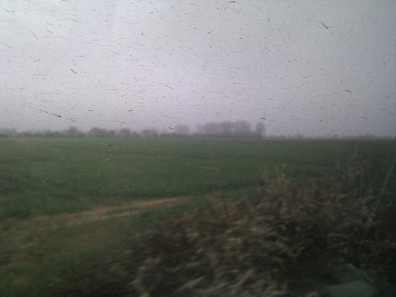 English countryside through a dirty train window