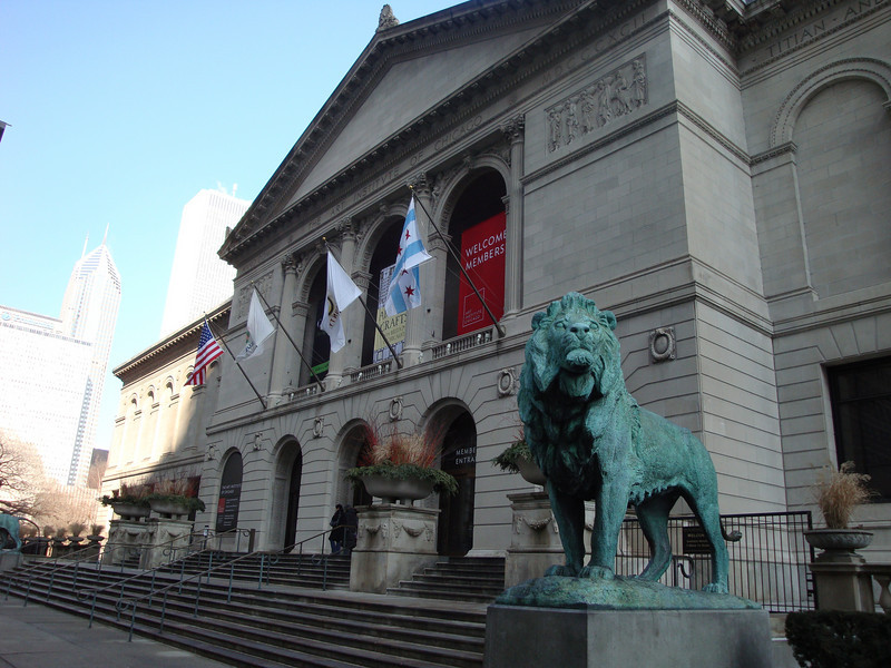One of two beautifully sculptured bronze lions in front of the institute.