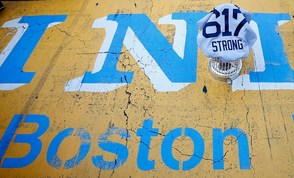 . BOSTON, MA - NOVEMBER 02:  The World Series trophy and the \'Boston Strong 617\' jersey sit on the finish line of the Boston Marathon on Boylston Street during the World Series victory parade on November 2, 2013 in Boston, Massachusetts.  (Photo by Jared Wickerham/Getty Images)