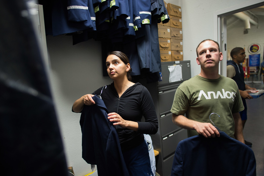 . Staff Sgt. Anahi Ledezma, left, and Senior Airman Joseph Trujillo receive their ceremonial uniform at March Air Reserve Base in Riverside, Calif. on Tuesday, May 12, 2015. (Photo by Watchara Phomicinda/ Los Angeles Daily News)