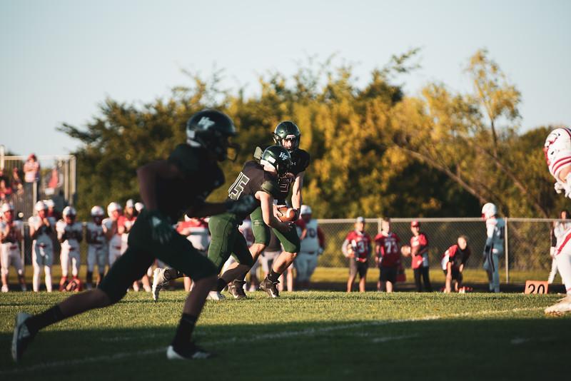 Holy Family Varsity Football vs. Mound Westonka, 8/29/19: Jake Kirsch '21 (13) & Captain Nick Hendler '20 (15)