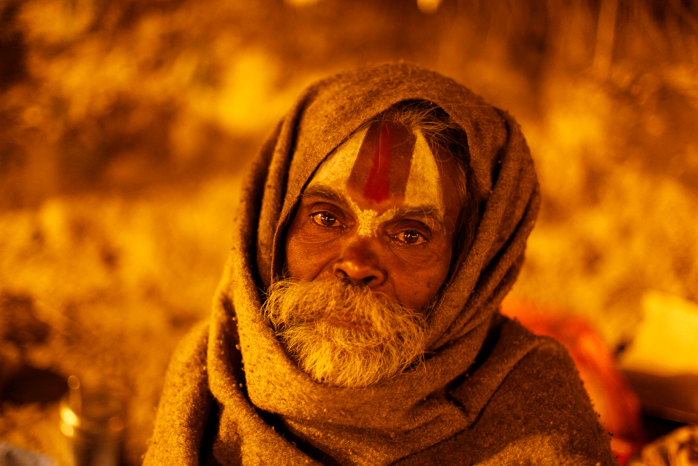 . An Indian Hindu holy man rests at the Sangam, the confluence of the rivers Ganges, Yamuna and mythical Saraswati, during the Maha Kumbh Mela in Allahabad, India Saturday, Jan. 26, 2013. Millions of Hindu pilgrims are expected to attend the Maha Kumbh festival, which is one of the world\'s largest religious gatherings that lasts 55 days and falls every 12 years. During the festival pilgrims bathe in the holy Ganges River in a ritual they believe can wash away their sins. (AP Photo/ Rajesh Kumar Singh)