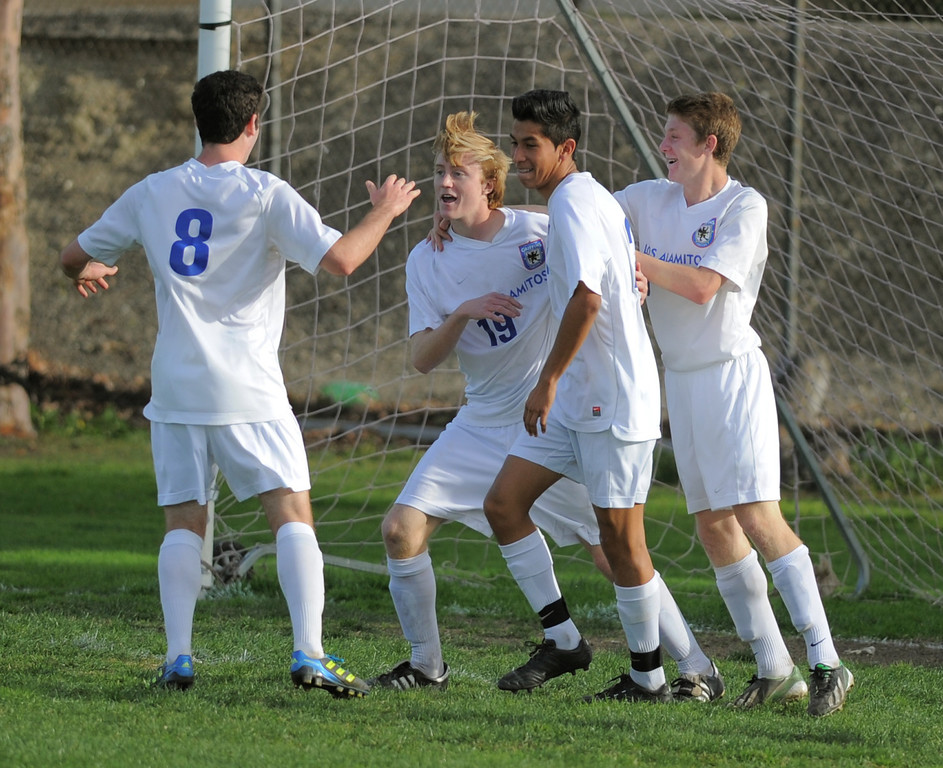. 02-15-2012--(LANG Staff Photo by Sean Hiller)- Los Alamitos beat Buena 4-1 in the first round of the Division 1 boys soccer playoffs Friday at Laurel School in Los Alamitos. Kevin Herring (19) celebrates after scoring first half for Los Alamitos.