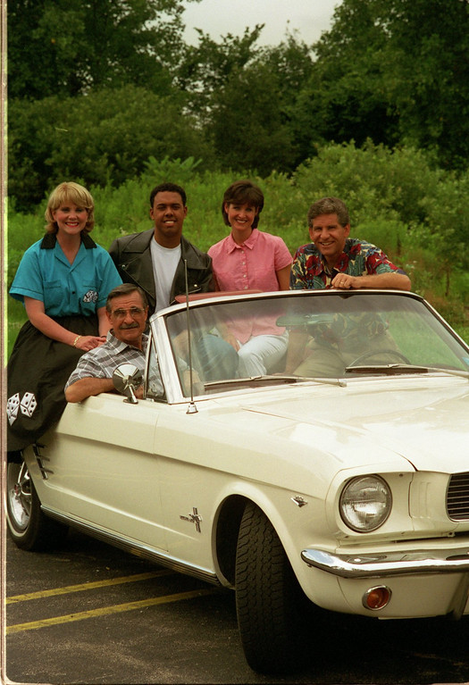 . Channel 7 Dream Cruise Special. (top) Mary Conway, Chris Lawrence, JoAnne Pertan, and Guy Gordon. (Seated)is Dick Purtan in this 1966 Mustang Convertable.