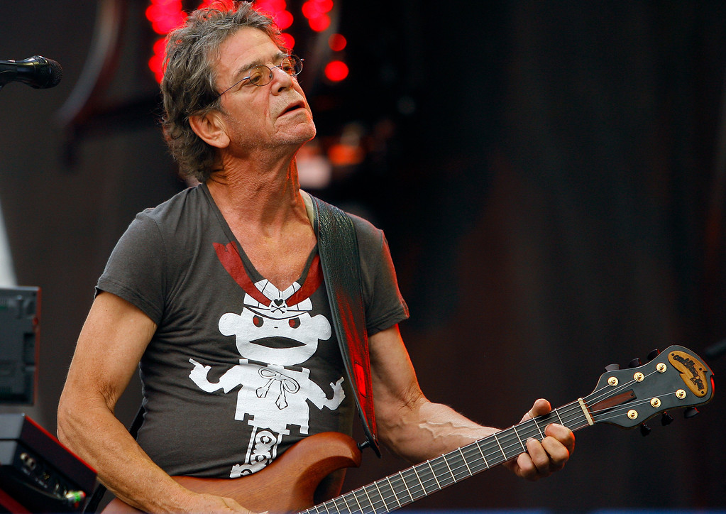 . FILE - In this Sunday, Aug. 9, 2009 file photo, Lou Reed performs at the Lollapalooza music festival, in Chicago. Punk-poet, rock legend Lou Reed is dead of a liver-related ailment, his literary agen said Sunday, Oct. 27, 2013. He was 71.  (AP Photo/John Smierciak, File)