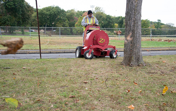 10/08/19 Wesley Bunnell   StaffrrCity employee Benny Morales uses a riding leaf blower to tidy up Stanley Quarter Park on Tuesday afternoon.