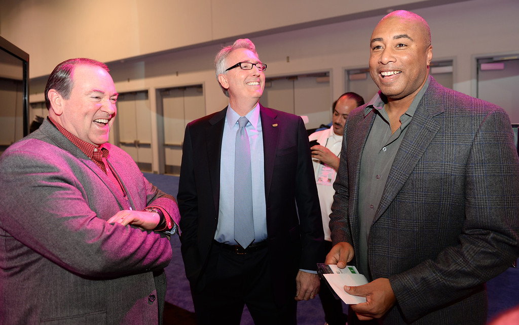 . President and CEO Joe Lamond, center, visits with former Governor Mike Huckabee, left, and former New York Yankee Bernie Williams, right during the Media Preview event for the NAMM Show at the Anaheim Convention Center on Wednesday January 22, 2014. The NAMM Show, National Association of Music Merchants, is a trade-only event for the music products industry that is held every January. It is one of the two largest music product trade shows in the world. (Staff Photo by Keith Durflinger/San Gabriel Valley Tribune)
