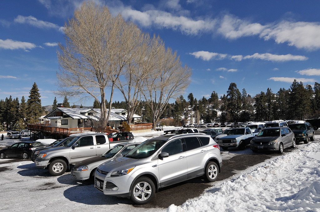 . A parking lot that once housed the command post for the Christopher Dorner manhunt is reopened to skiers and snowboards in Big Bear on Sunday, Feb. 10, 2013. Search crews were reduced 25 personnel on Sunday from 50 the day before. (Rachel Luna / Staff Photographer)