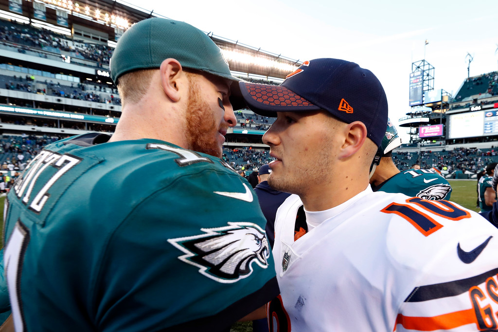 . Philadelphia Eagles\' Carson Wentz, left, and Chicago Bears\' Mitchell Trubisky meet after an NFL football game, Sunday, Nov. 26, 2017, in Philadelphia. Philadelphia won 31-3. (AP Photo/Chris Szagola)
