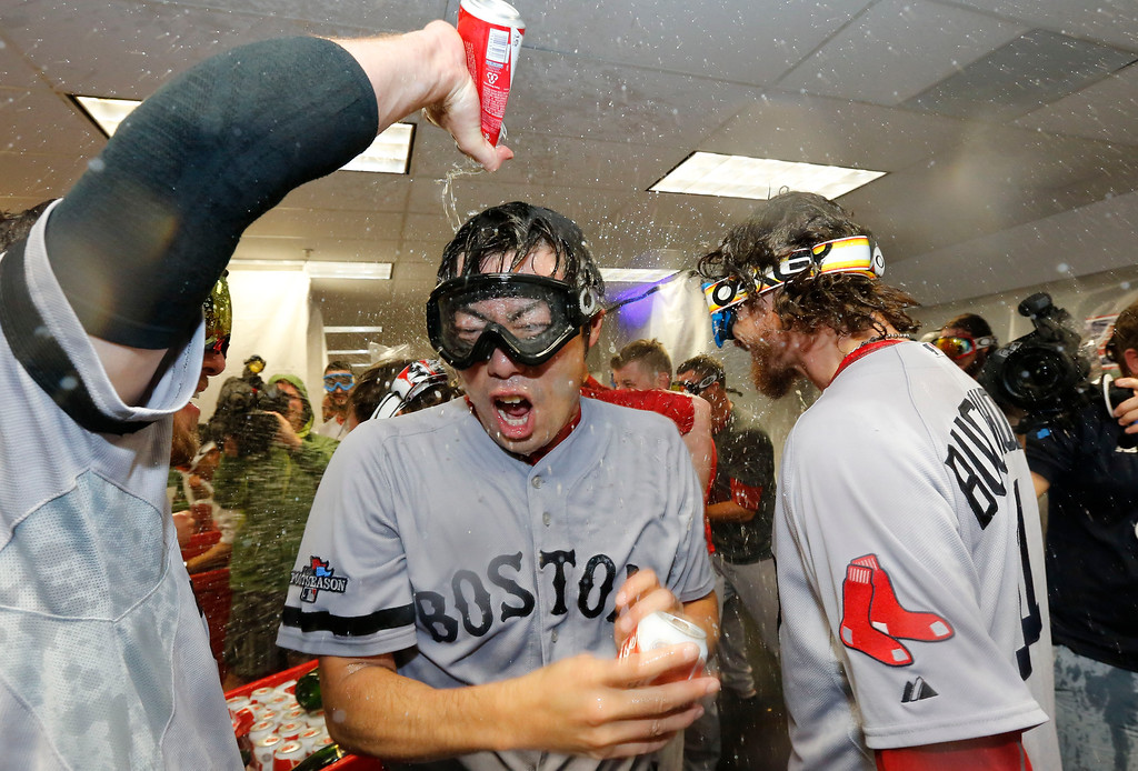 . Boston Red Sox pitcher Koji Uehara celebrates after the team defeated the Tampa Bay Rays in Game 4 of an American League baseball division series, Wednesday, Oct. 9, 2013, in St. Petersburg, Fla. The Boston Red Sox\'s defeated the Tampa Bay Rays 3-1 to move on to the American League Championship Series. (AP Photo/Mike Carlson)