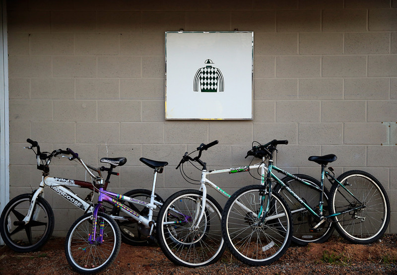 . Bikes lay against a barn wall during early morning workouts ahead of the 140th Kentucky Derby at Churchill Downs on May 2, 2014 in Louisville, Kentucky.  (Photo by Jamie Squire/Getty Images)