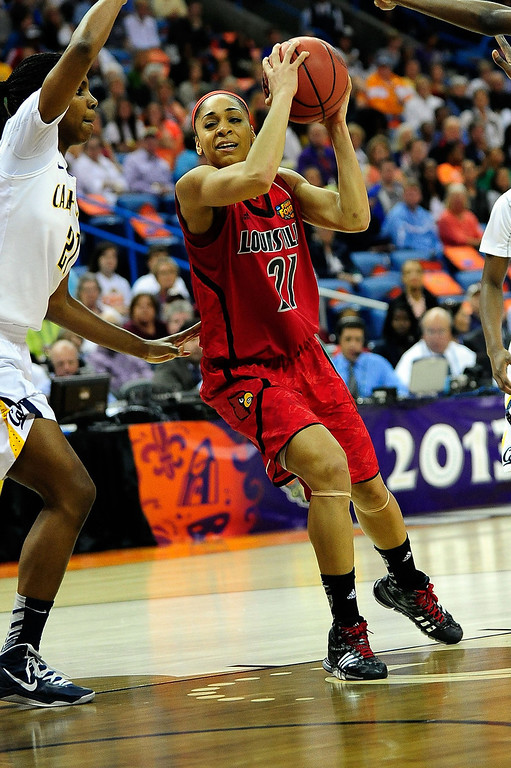 . Bria Smith #21 of the Louisville Cardinals drives against the California Golden Bears during the National Semifinal game of the 2013 NCAA Division I Women\'s Basketball Championship at New Orleans Arena on April 7, 2013 in New Orleans, Louisiana. (Photo by Stacy Revere/Getty Images)