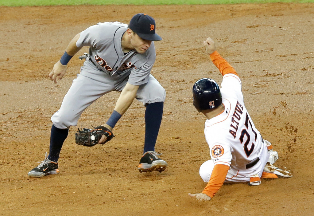 . Houston Astros\' Jose Altuve (27) steals second base as Detroit Tigers second baseman Ian Kinsler moves in for the tag in the third inning of a baseball game Saturday, June 28, 2014, in Houston. (AP Photo/Pat Sullivan)
