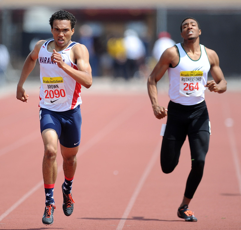 . Maranatha\'s Kyle Brown, left, won the 400 meters race as Bonita\'s Devin Rutherford, right, finished fourth during the Arcadia Invitational at Arcadia High School on Saturday, April 6, 2013 in Arcadia, Calif.  (Keith Birmingham Pasadena Star-News)