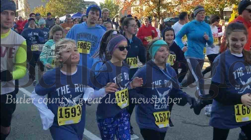 Jim Smith photoRunners take off Saturday morning in the 38th Annual Butler YMCA Turkey Trot in Butler. The event — a 5K race and a one-mile kids run — attracted about 350 runners despite freezing temperatures. 3 col. pic