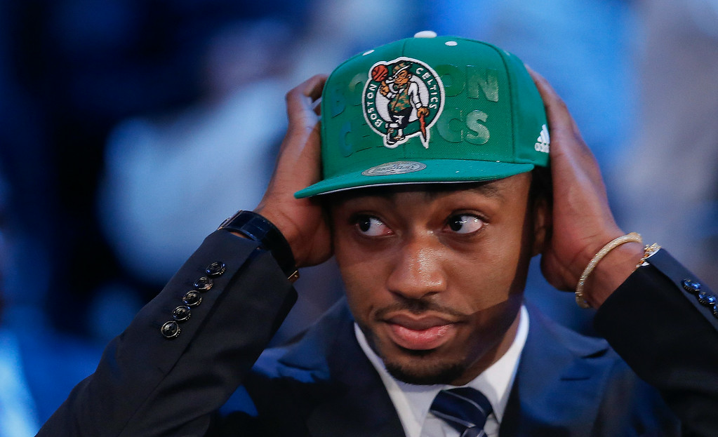 . Kentucky\'s James Young dons a Boston Celtics cap after being selected as the 17th overall pick by the Celtics during the 2014 NBA draft, Thursday, June 26, 2014, in New York. (AP Photo/Kathy Willens)