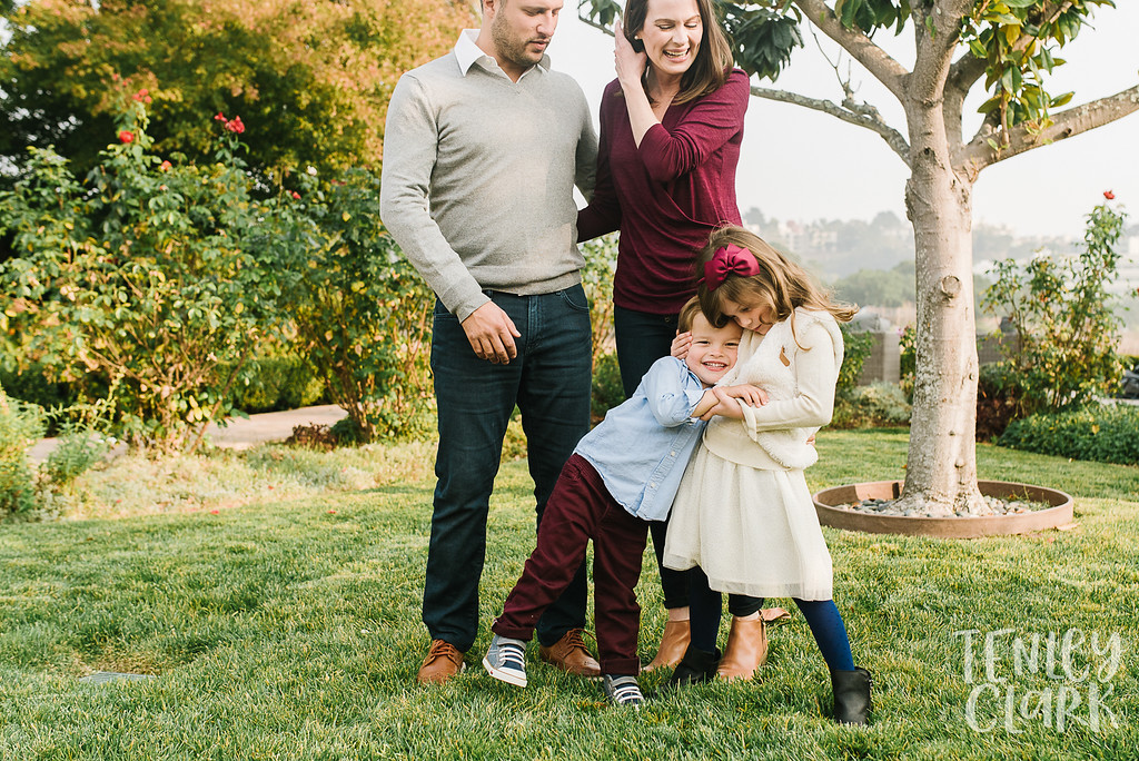 Backyard family hug. Lifestyle in-home family photoshoot in Marin, CA by Tenley Clark Photography.