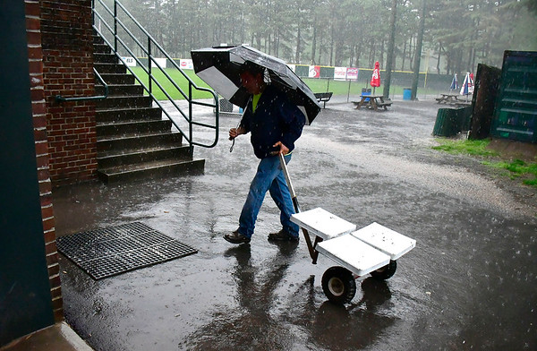 5/29/2019 Mike Orazzi | Staff Bristol Park & Recreation's Dean Dionne puts away the bases as the season opening game for the Bristol Blues got canceled because of rain in Bristol Wednesday night.