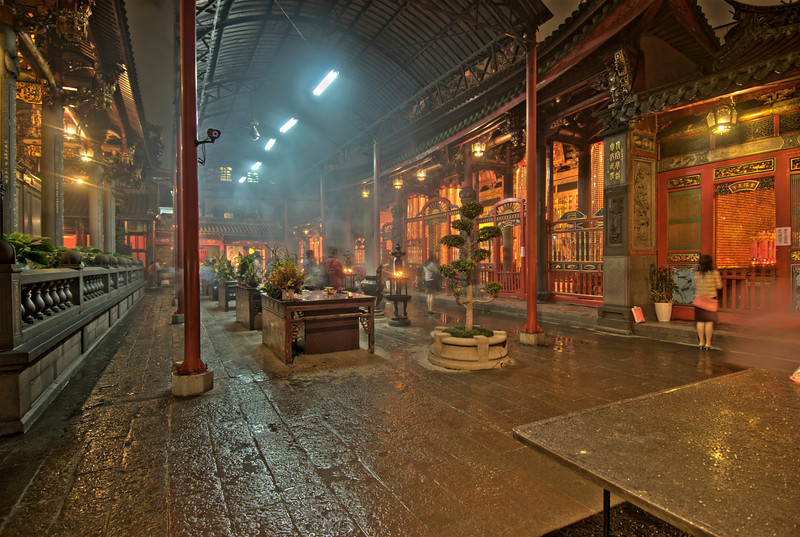 Smoke from incense inside Longshan Temple - Taipei, Taiwan
