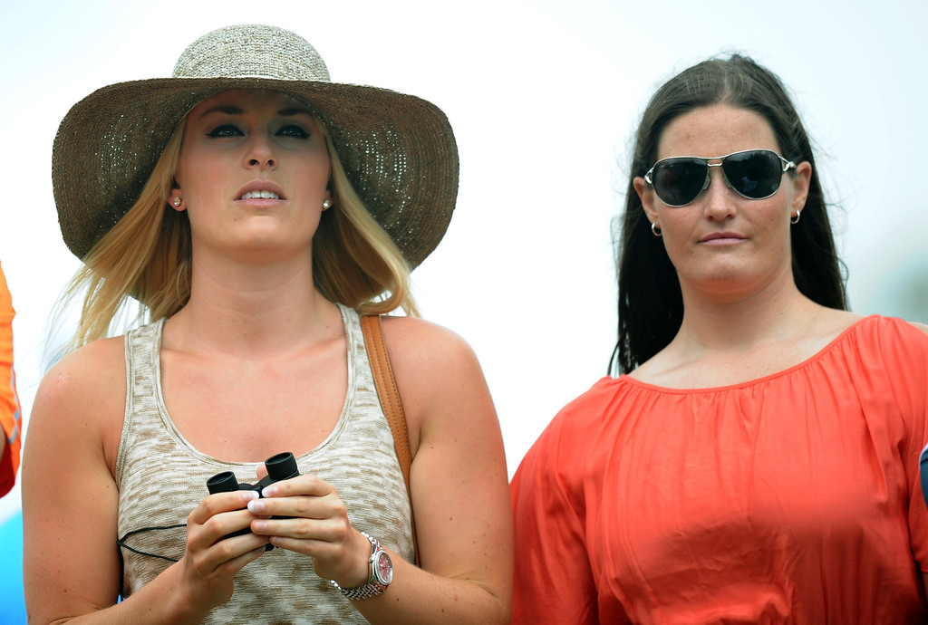 . US Olympic skier Lindsey Vonn(L)  and her physical therapist Lindsay Winninger watch Tiger Woods of the US during the first round of the 77th Masters golf tournament at Augusta National Golf Club on April 11, 2013 in Augusta, Georgia.     JIM WATSON/AFP/Getty Images