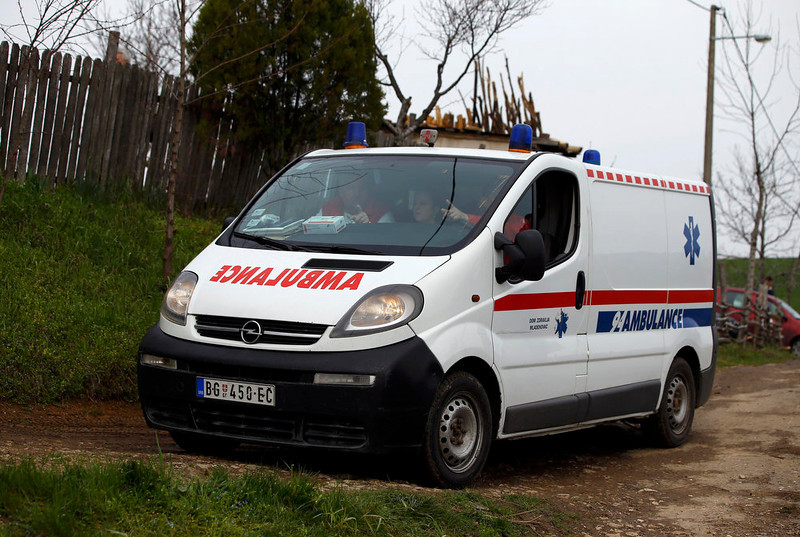 . An ambulance car is parked in the village of Velika Ivanca, about 40 km (25 miles) southwest of Belgrade April 9, 2013. A gunman shot dead 13 people, including his mother and son, in an early-morning rampage through a small Serbian village southwest of the capital Belgrade on Tuesday, authorities said. Those killed included a two-year-old child. The gunman, identified by police as Ljubisa Bogdanovic - a war veteran born in 1953 - also shot his wife before turning the gun on himself. Both were in critical condition in hospital, police said.       REUTERS/Marko Djurica