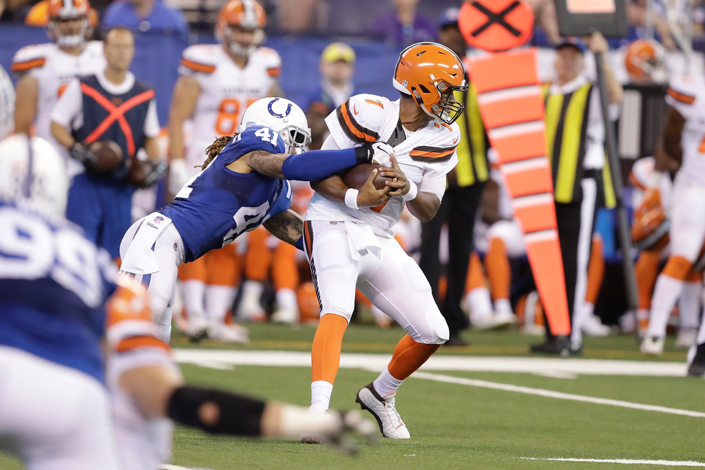 . Cleveland Browns quarterback DeShone Kizer (7) is sacked by Indianapolis Colts strong safety Matthias Farley (41) during the second half of an NFL football game in Indianapolis, Sunday, Sept. 24, 2017. (AP Photo/Darron Cummings)