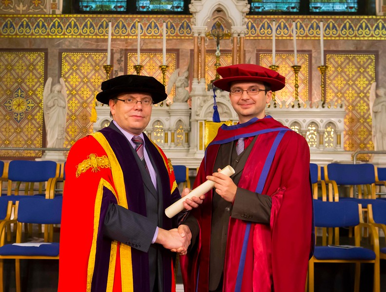 Waterford Institute Of Technology Conferring. Pictured at WIT Waterford Institute Of Technology Conferring is Cristian Olariu from Brazil, who was conferred a Doctor of Philosophy by Dr. Ruaidhrí Neavyn, President WIT. Picture: Patrick Browne