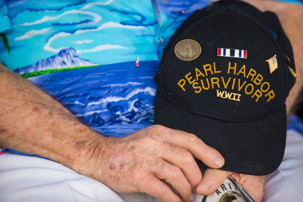 . Pearl Harbor Survivor Paul Kennedy of Indiana holds his hat during the singing of the National Anthem at the 71st Annual Memorial Ceremony commemorating the WWII Attack On Pearl Harbor at the World War 2 Valor in the Pacific National Monument December 7, 2012 in Pearl Harbor, Hawaii. This is the 71st anniversary of the Japanese attack on pearl Harbor.  (Photo by Kent Nishimura/Getty Images)