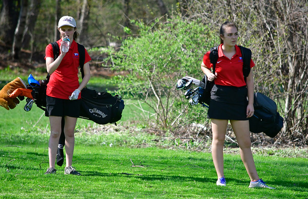 4/23/2019 Mike Orazzi | Staff St. Paul's Erin Downes and Natalie Millerick at the Westwoods Golf Course on Tuesday.
